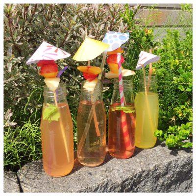 4 flesjes op een rijtje